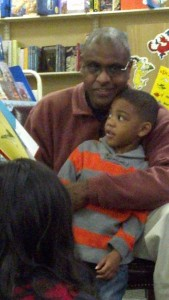 Dr. Jeffrey Leak and son reading Green Eggs and Ham