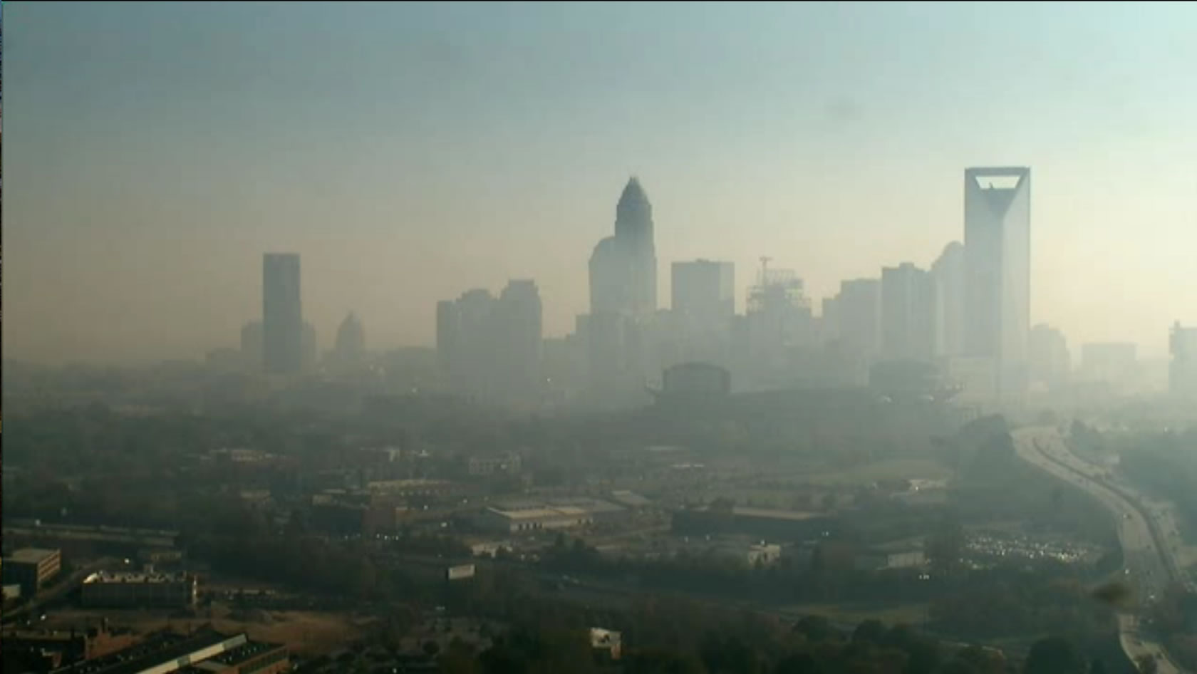 Image of Charlotte, North Carolina in November 2016 after smoke was transported from fires on the eastern NC Appalachian mountains.  Air Quality Index was red for a day, which is really rare.  Photo is from WBTV tower cam.