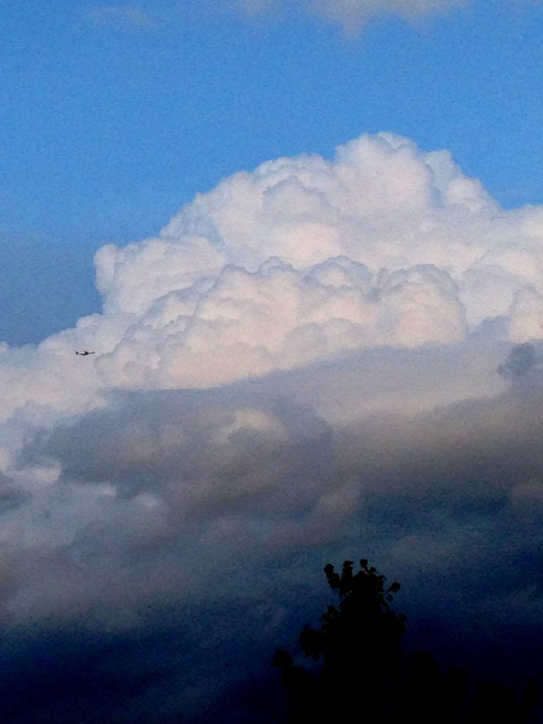 Great looking cumulonimbus cloud rising over north Charlotte.  Note the commercial aircraft for scale.